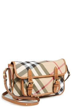 This Burberry crossbody satchel is the perfect travel companion.