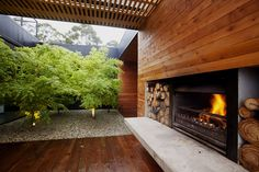 Modern courtyard with a fireplace