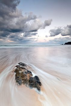 """Swirling Tide"" – Espasa Beach, Spain – Lujo Semeyes - Featured Photographer"