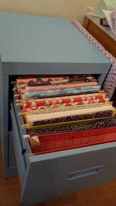 how to store fabric- another good idea.