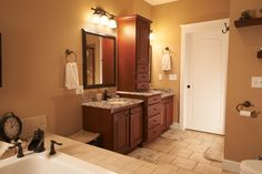 His-and-her sinks and storage in the master bathroom. A must have!