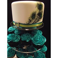 Hand Painted Peacock Feather Wedding Cake with Teal Buttercream Cupcakes. Maybe with purple frosting instead of teal