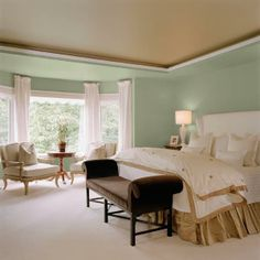 Cool blue-green livens up a neutral bedroom without sacrificing calming tones. Shown here: Mountain Ash 21-25, Pratt & Lambert. | Photo: Courtesy of Pratt & Lambert