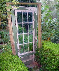 An old door for a gate...love this idea!!!