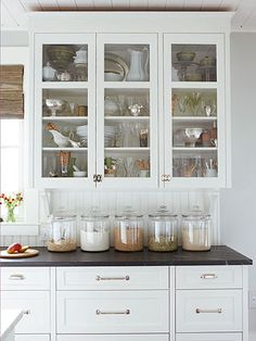 25 Home Improvement Ideas Under $150  Glass cabinets above countertop in kitchen entry-way