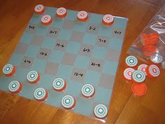 If I cover my checker board with a sheet of self-stick laminate, I can change the math problems.
