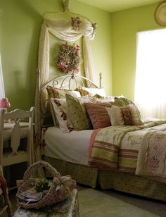 Cottage bedroom with a wispy canopy and an apple green wall,
