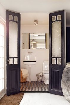 Love the doors.  An interior use like this between bedroom and bathroom would be a good use of the awesome doors at the architectural salvage places we've found recently.