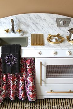 play kitchen makeover, gold accents, faux marble countertops