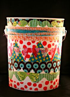 Pretty up a 5 gallon bucket with fabric and Mod Podge. This would be a great way to decorate my flour buckets!