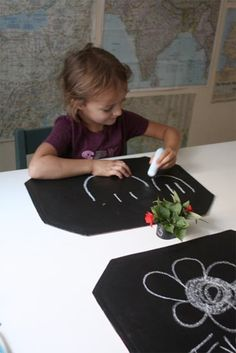 Spray vinyl placemats with chalkboard paid