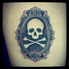 skull in frame tattoos