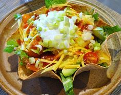Very quick and easy Tex-Mex Taco Salad Bowl by Karen Calanchini,  Cuisine: Southwest, Tex-Mex. 2 servings.  Ingredients: 2 large wheat flour tortilla shells (I buy fat-free or low carb shells)  2 boneless and skinless chicken breasts,  Vegetable oil,  Cumin,  Garlic Powder,  Salt,  Cayenne Pepper,  Refried Bean Filling. Preparation: Preheat oven to 275 degrees F. How To Make Tortilla Bowls: Place flour tortillas into Tortilla Bowl Makers or oven-safe bowls (that will hold the tortillas), sprayed with...