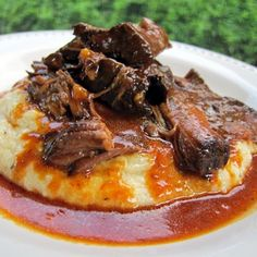 GOODNESS this sounds like perfection... BBQ Pot Roast over Cheddar Ranch Grits