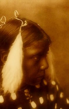 Red Cloud's Granddaughter. Photograph by Edward S. Curtis's The North American Indian.