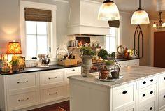 white kitchen cabinets with range hood