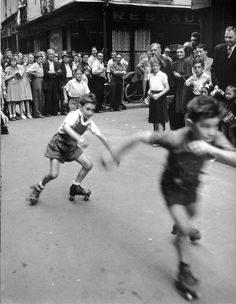 © Robert Doisneau. Boys roller skating Paris 1950s