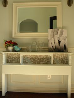 headboard turned hall table - could add shelf on bottom for more of a bookcase style.  great repurposing idea