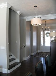 love dark floors, thick trim and molding, non-carpeted stairs