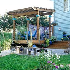 Dress Up Your Deck-Make a boxy builder deck look like a custom addition with decorative metal or glass balusters and post caps that double as planters or light fixtures. Add delightful details with colorful plants, pillows, furniture, outdoor rugs, and accessories.