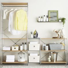 Create an open closet or organize your reach in with modular chrome shelving system from Crate & Barrel