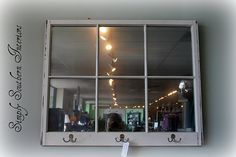 old window pane with Krylon's Looking Glass spray paint + hooks for the entryway