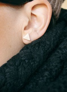 Simple + silver, these Tiny Brushed Triangle Studs are the perfect basic for your jewelry box! $12