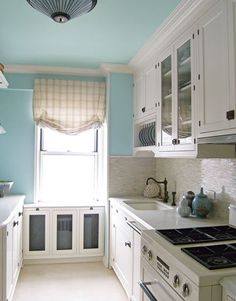 white kitchen, blue walls, robin egg blue, blue kitchens, paint colors, galley kitchens, benjamin moore, painted ceilings, white cabinets