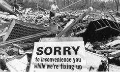 A sign expressing regret for Hurricane Camille's destruction lies on a pile of rubble in Waveland, Miss., that used to be a post office. August 1969