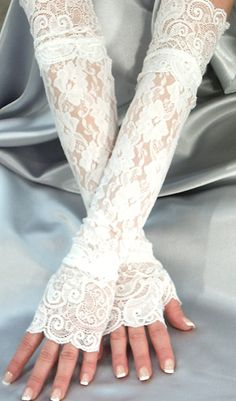 lacey fingerless 'gloves'. I say, 'frill for your forearm'...
