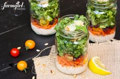 Chopped Italian Salad in a Jar | Arugula is layered with garbanzo beans, tomatoes, shaved parmesan cheese and more with a homemade Caesar dressing.  While this recipe doesn't have any meat, you can add chopped salami or prosciutto.  #picnicfood