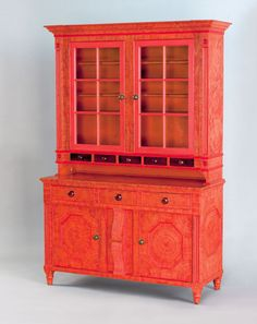 "Pook & Pook. 10/25/08. Lot 271.  Est: $80K - $120K. Realized: $198,900. Berks County, PA. painted 2 part Dutch cupboard dated 1849, the upper section with molded cornice & 2 glazed doors, above 5 tiger maple candle drawers. Molded pilasters with bull's-eye capitals & plinths. Lower section with 3 short drawers & 2 cupboard doors with recessed octagonal panels. Retains original pristine surface with orange & salmon swirl decoration. 81 1/2"" h., 52 3/4"" w."