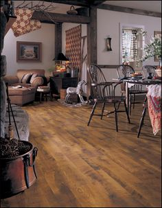Laminate is a manufactured product that simulates the look of hardwood, ceramic tile, natural stone and many other types of flooring. In the past, laminate floors have been easy to spot, but today's technology allows manufacturers to create realistic visuals and textures for an elegant and quality floor.
