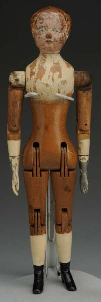 Joel Ellis Wood Doll.  American, 1873. All wood with carved hair, fully jointed with metal lower arms and legs.