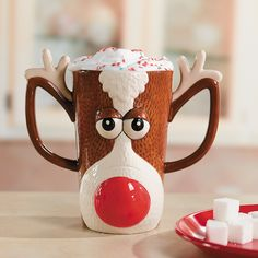 This Reindeer Face Mug is a fun and playful way to enjoy your favorite holiday beverage.