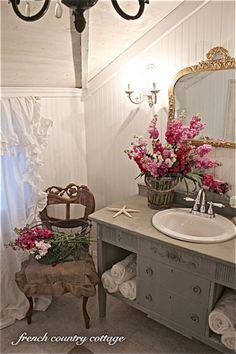 Love how they used this old sideboard as a vanity.