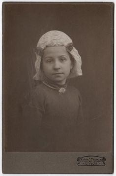 Little Dutch girl in a jewelled veil.