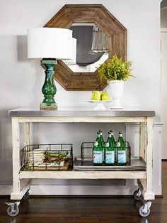 Wire baskets add character and smart storage to this repurposed beverage cart. Foyer table. Bar cart. #bhg #vintage