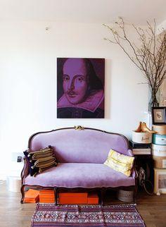 Lavender sofa with orange accessories