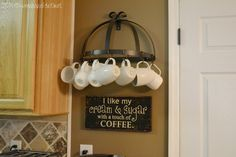 Use a metal pot holder and shower curtain clips to hang coffee mugs above your #Keurig in your #DIY Coffee Station!