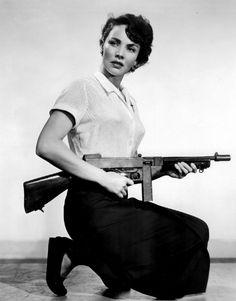 A beautiful girl with gun