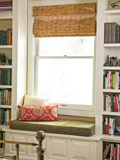 Adding bookshelves in the master bedroom created a snug spot for a cushioned window seat. | Photo: Mark Lohman