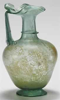 A ROMAN GLASS JUG  CIRCA 3RD-4TH CENTURY A.D