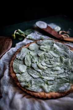 Peppermint White Chocolate Tart With A Hazelnut Crust & Candied Mint Leaves