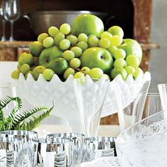 Edible Centerpiece | Heap fruits that are of a similar green shade—such as grapes, limes, and apples—in a large milk-glass compote for an easy arrangement that is pretty and delicious