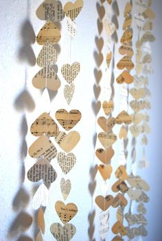 Love song sheet music cut into hearts and strun to make a garland