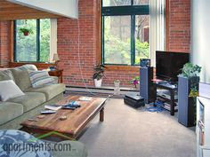 Love all the sunlight and #exposed #brick in this #living #room #tijolo