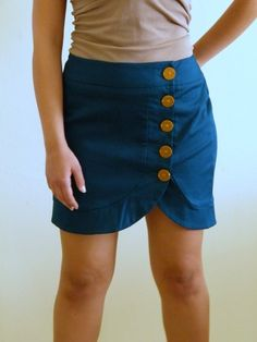 Turquoise button down skirt.