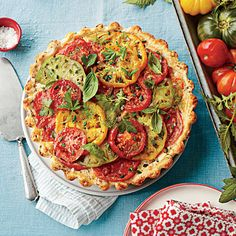 Tomato, Cheddar, and Bacon Pie | We raised the ante on classic tomato pie with a sour cream crust studded with bacon, layers of colorful tomatoes, and plenty of cheese and herbs to tie it all together. | #Recipes | SouthernLiving.com sour cream, garden tomatoes, cheddar, bacon recipes, pies, pie recipes, bacon pie, tomato pie, savori tomato