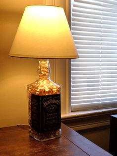 Tryin to think of more manly decor to make my other half feel included in the interior and whats more manly than a Jack Daniels Bottle? Diy Crafts, Diy Man Decor, Man Diy, Daniel Bottles, Jack Daniels Bottle, Diy Liquor Bottles Lamps, Liquor Bottles Crafts, Man Caves, Diy Projects